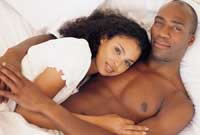 Couples in the bedroom fertility tips with Awakening Fertility